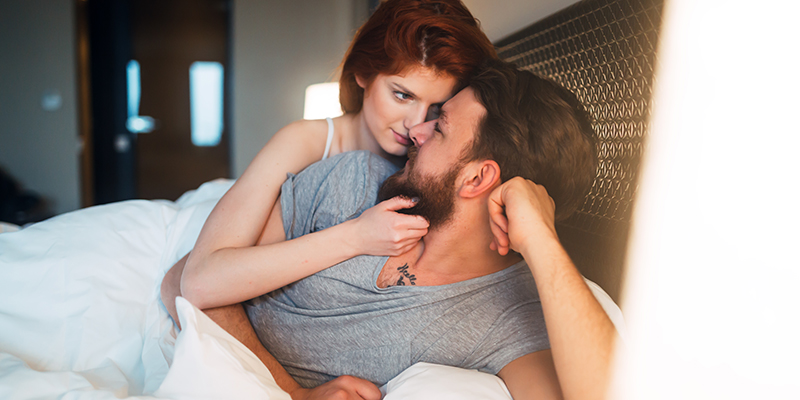 happy couple in bed. can cbd help with your libido? cbd intimacy oil.