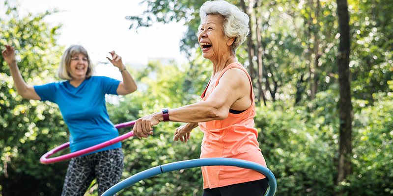 senior woman exercising with a hula hoop. does hemp oil help with anxiety.